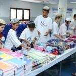 מתנדבי חסדי נעמי אורזים ערכות חזרה לבית הספר